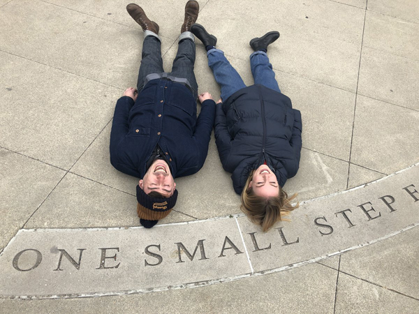 Actors lying down outside during One Small Step American tour